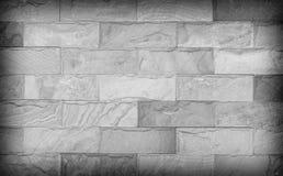 Textur för sandstenväggen och ackground av dekorerar, grånar färg Arkivbild