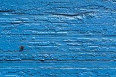 textur Gammal målad vägg av huset gammalt trä för staket blå målarfärg Fluga ombord arkivbild