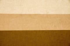 Textur gjorde randig murbruk av tre bruna signaler Arkivfoton