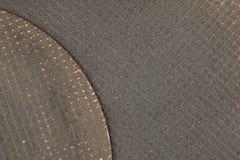 Textur närbild av en bitande diskett för metall Arkivfoto