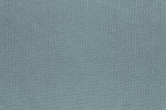Textur och bakgrund av blek färg för tyg Royaltyfri Foto