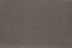 Textur och bakgrund av mörk beige färg för tyg Arkivfoto