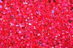 Textur och bakgrund av röda kiselstenar arkivfoto