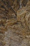 Textur och bakgrund av stenen Gult och grått med krater royaltyfria foton