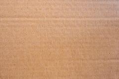Textur och bakgrund för pappers- ask för papp för slut övre brun royaltyfri bild