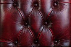 Textur och modell av rött mörkt läder Lyxig textur, textur för stol för lyxläder knapp-tufted röd royaltyfri bild