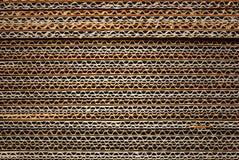 Textur som staplas av industriell papp Arkivfoton