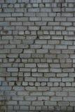 Textur tegelsten för bakgrundsväggljus med en stor spricka Royaltyfri Fotografi