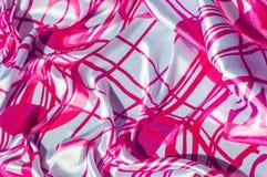 Textur tyg, bakgrund Textur av en kvinnlig klänning med ett a Arkivbild