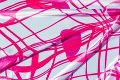Textur tyg, bakgrund Textur av en kvinnlig klänning med ett a Arkivfoton