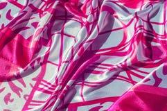 Textur tyg, bakgrund Textur av en kvinnlig klänning med ett a Arkivfoto