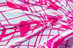 Textur tyg, bakgrund Textur av en kvinnlig klänning med ett a Royaltyfria Bilder