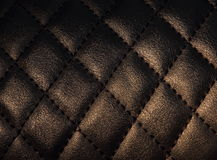 Textur vadderad svart med det gula panelljuset Royaltyfri Fotografi