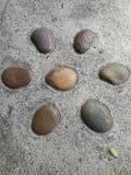 Textura à terra de pedra rocha pequena do seixo Fundo da rocha Imagem de Stock