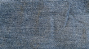 Textura áspera azul das calças de brim Fotografia de Stock Royalty Free