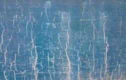 Textura áspera azul do teste padrão com tão muitas rachaduras. Imagens de Stock
