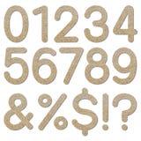 Textura áspera 0 a 9 numéricos de la grava de la fuente Imagen de archivo