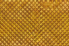 Textura abstracta de un viejo lujo natural, cuero moderno del fondo del estilo del oro con rombos imagen de archivo