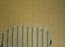 Textura acanalada y rasgada de la cartulina foto de archivo