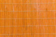 A textura alaranjada de madeira de bambu com textura natural da esteira dos testes padrões pode Imagem de Stock Royalty Free