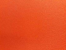 Textura alaranjada de pano Imagem de Stock