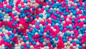Textura alegre da bola Fundo vermelho, azul e branco da foto dos balões Bolas francesas da cor da bandeira fotos de stock royalty free