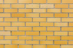 Textura amarela do fundo da parede de tijolos Fotografia de Stock Royalty Free