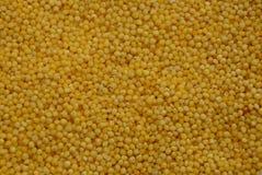Textura amarela do painço pequeno dos cereais no montão Imagens de Stock