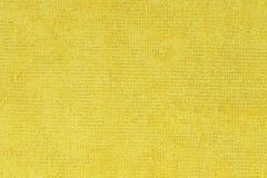 Textura amarilla de la tela Foto de archivo libre de regalías