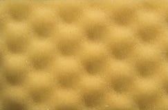 Textura amarilla del caucho de espuma Fotografía de archivo