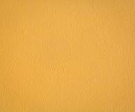 Textura amarilla del muro de cemento Fotos de archivo