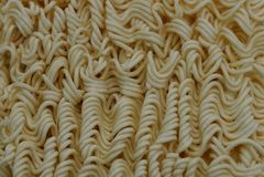 Textura amarilla gris de las pequeñas pastas secas fotografía de archivo