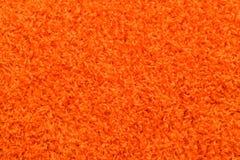 Textura anaranjada de la alfombra Fotografía de archivo libre de regalías