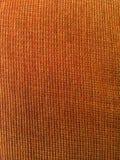 Textura anaranjada de la tela Foto de archivo