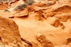 Textura anaranjada de las dunas de arena como fondo Foto de archivo
