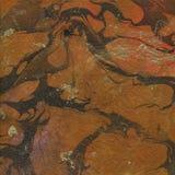 Textura anaranjada del papel veteado del marrón y del oro Imagen de archivo