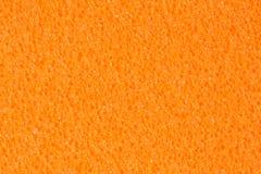 Textura anaranjada saturada de EVA de la espuma con la superficie porosa del contraste fotografía de archivo libre de regalías