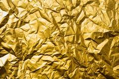 Textura arrugada extracto arriba detallado de la hoja de oro Fotos de archivo libres de regalías