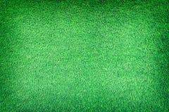 Textura artificial de la hierba para el fondo Foto de archivo libre de regalías