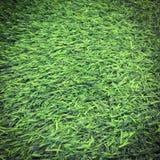 Textura artificial de la hierba verde para el fondo y la sombra fotografía de archivo libre de regalías
