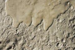 Textura ascendente abstracta del cierre mojado del fango que fluye Imagenes de archivo