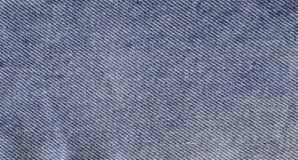 Textura azul abstracta del dril de algodón Fondo de la mezclilla azul Foto de archivo libre de regalías