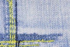 Textura azul da beira da emenda das calças de brim da sarja de Nimes Fotos de Stock Royalty Free