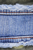 Textura azul da beira da emenda das calças de brim da sarja de Nimes Imagem de Stock Royalty Free
