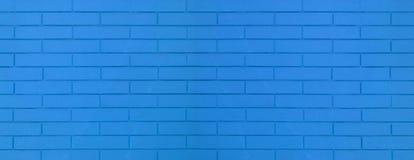 Textura azul da parede de tijolo da cor para imagens de fundo gráficas fotografia de stock royalty free