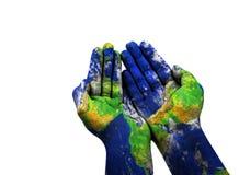 A textura azul da terra em uma mão do ` s da mulher Fotos de Stock Royalty Free