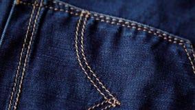 Textura azul das calças de brim da sarja de Nimes Fundo das calças de brim Vista superior vídeos de arquivo