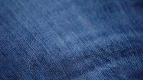 Textura azul das calças de brim da sarja de Nimes Fundo das calças de brim Vista superior filme