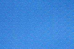 Textura azul de la estera de la yoga Imagenes de archivo