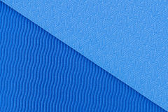 Textura azul de la estera de la yoga Foto de archivo libre de regalías